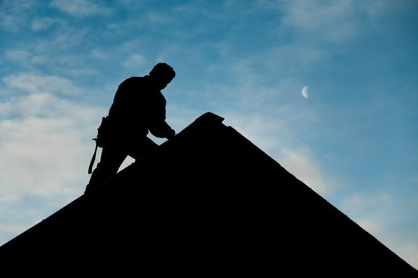 Roofing Contractors at Dusk